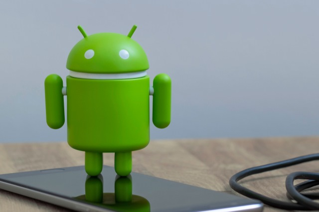 Android figure on smartphone