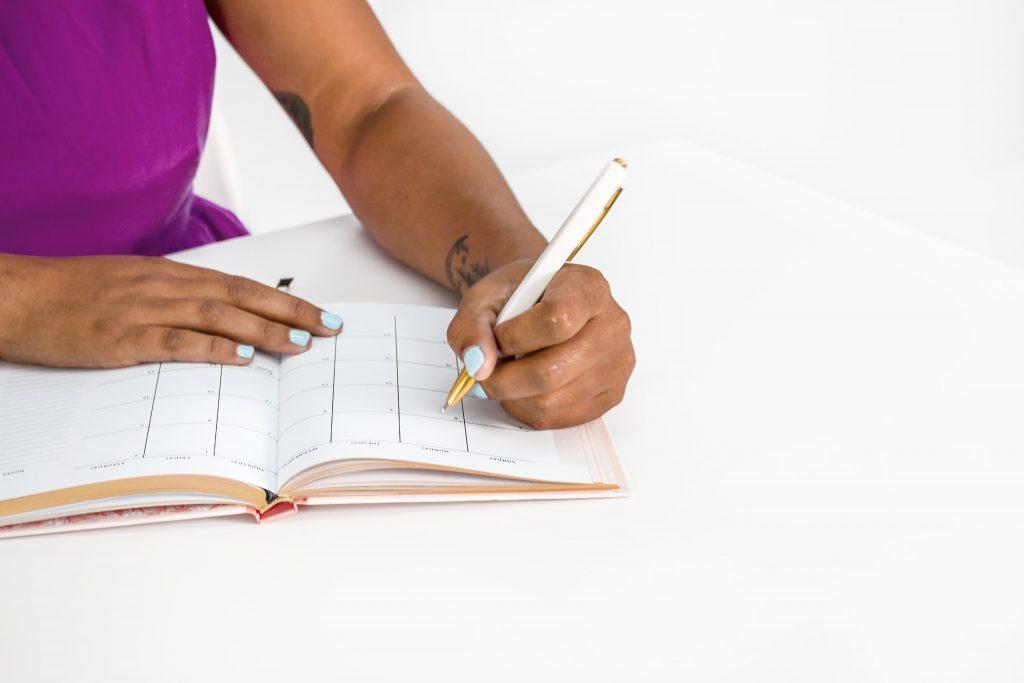 Woman writing a financial plan