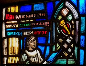 "stained glass window with the words ""Let everything that hath breath praise the Lord"""
