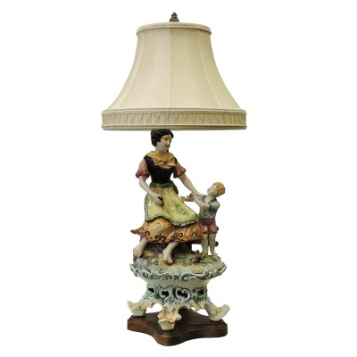 french woman with boy lamp
