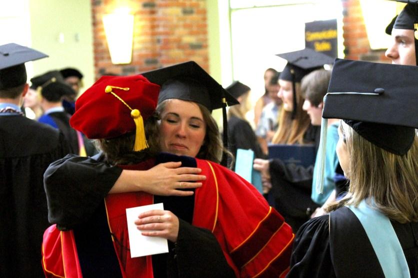 Prof. Kooistra congratulates Lauren