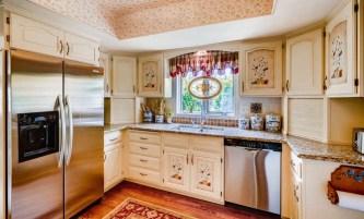 Neutral granite & ss appliances in kitchen