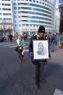 Denver Marade marcher with MLK picture in front of Denver Post building, Jan 2015