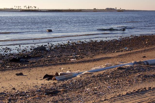 Gulf Coast beach near High Island, Texas, with trash and long pipe IMG_8936