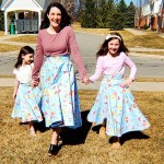 Three girls in their matching blue floral Beth Smith Textiles mommy and me skirts