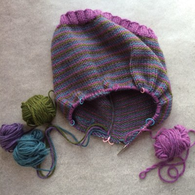 Hat with 4 balls of yarn attached.