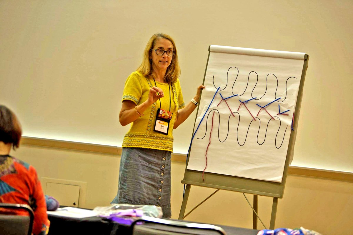 Photo of Beth teaching KLITCH at STITCHES Texas.