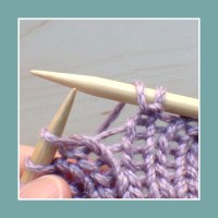 Between a purl and a knit stitch.