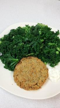 Spicy bean burger with boiled kale and peas