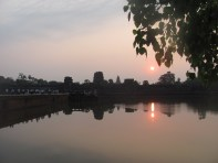 Beautiful sunrise reflected on the lake in front of the temple at Ankor