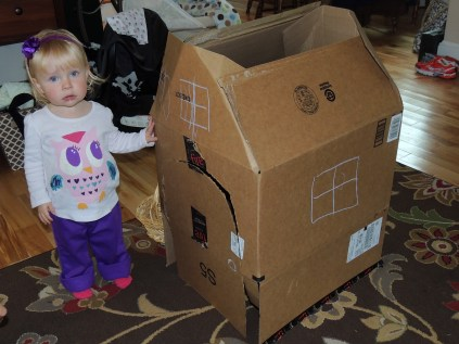 The best toy of all--a custom-made playhouse made from Amazon boxes!