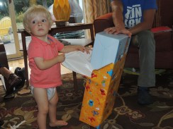 Opening presents and fending Charlotte off