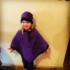 little girl and poncho hat
