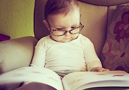 baby with reading glasses