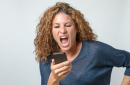 Angry young woman shouting at her mobile