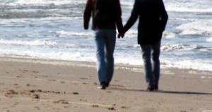 Couple Walking On The Beach For Refreshment