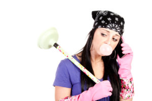 teen chewing gum and holding plunger
