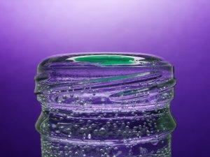 Glass water bottle full of water