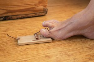 toe caught in mousetrap