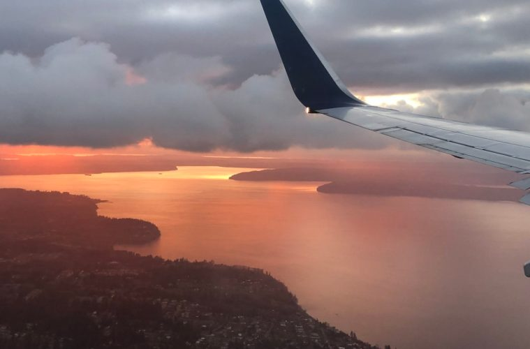 Plane wing and sunset