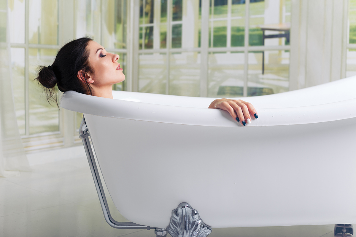 Woman relaxing in bath