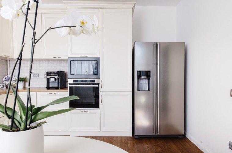 Modern appliances and new design in kitchen. Loft kitchen and ap