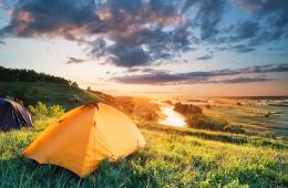 Camping in tent with sunrise