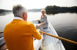 Elderly couple dating in boat