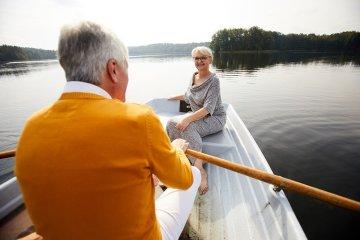 Elderly couple dating in boat
