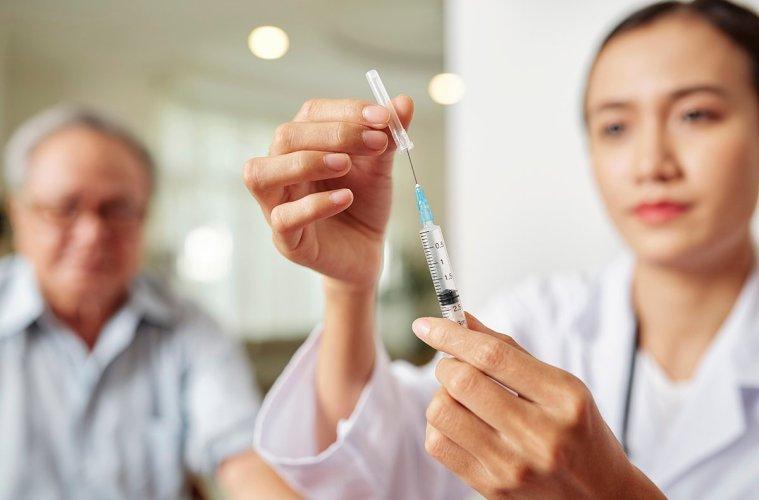 Doctor giving patient flu shot
