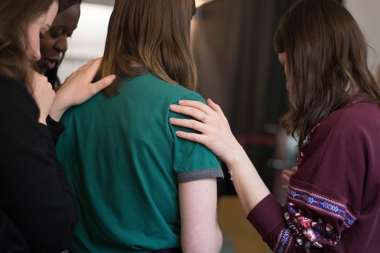 Woman being comforted by friends