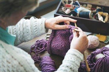 Woman crocheting a hat