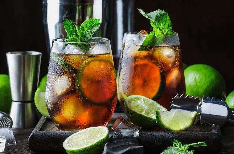 Cuba libre alcohol cocktail with golden rum, lemon juice, cola,