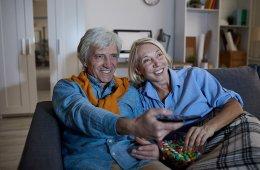 Senior Couple Watching TV at Night