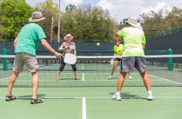 4 People playing Pickle Ball