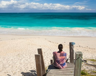 woman and turquoise waters and beach