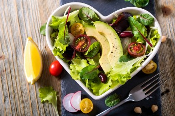 Healthy green salad with avocado, mangold leaves, red beans and