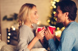 Couple in love drinking tea and enjoying winter holidays