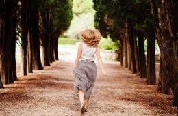 happy woman walk in forest