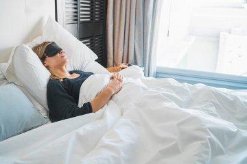 Woman sleeping with sleep mask.