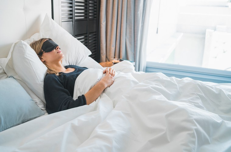 Woman sleeping with sleep mask.