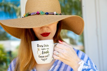 Woman with mug and hat