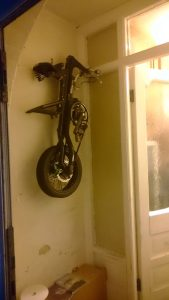 How I store my Strida hanging on the wall by the front door