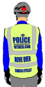 "A cyclist wearing a high-visibility vest with the words ""Police Witness.com Move Over"""