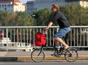A man riding a Brompton folding bike