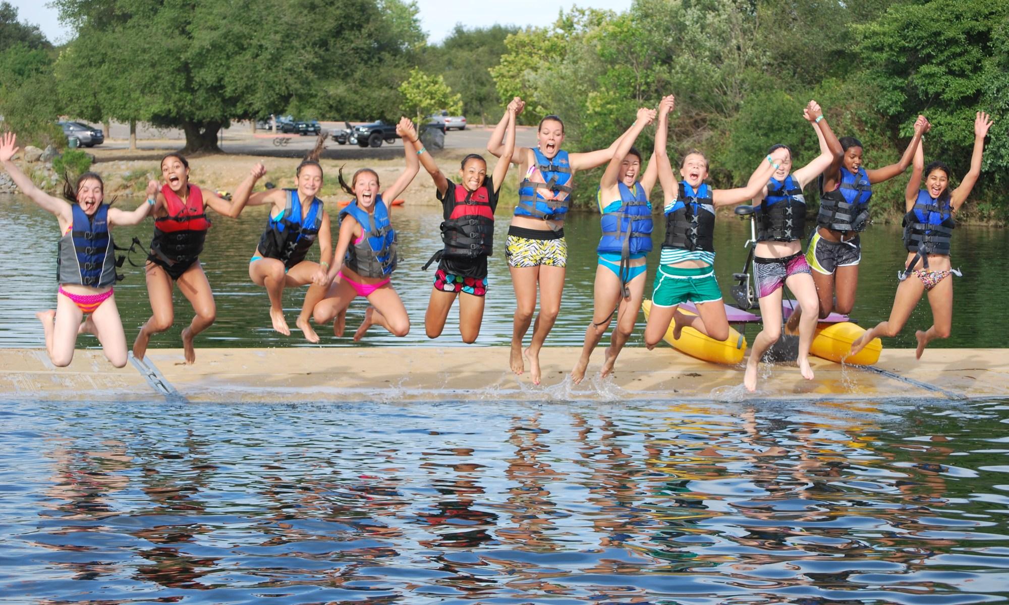 sacramento state aquatic centre kids jumping into the lake