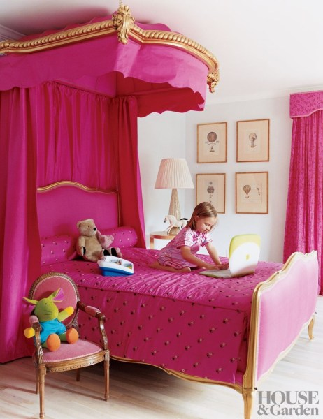 little girls pink bedroom with canopy bed Bedroom Makeover: 3 Fun Accessories Every Kid's Room Needs