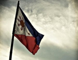 Philippines flag in grey sky