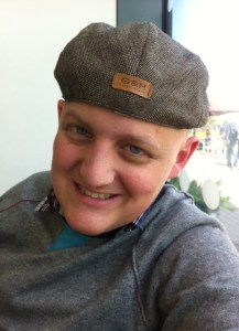 George with flat cap on backwards