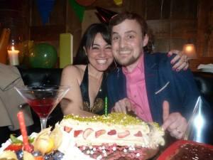 George and Mariacristina with '1' cake